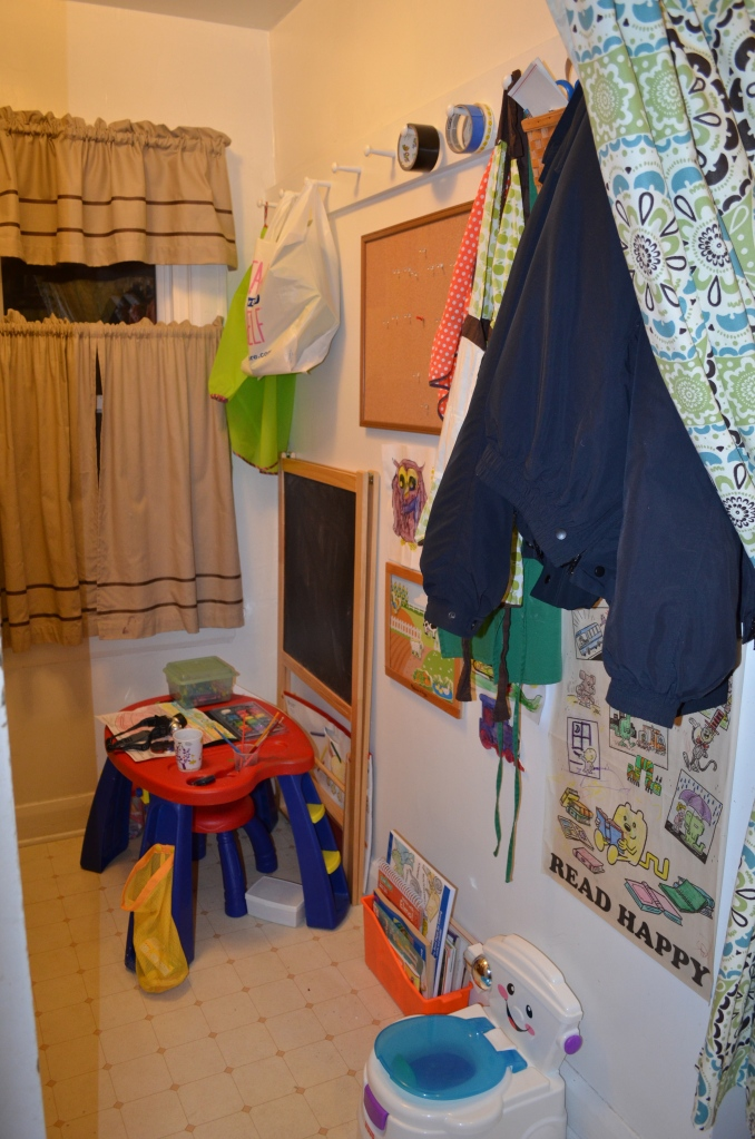 Simon's art stuff and personal potty area (because sometimes he waits TOO LONG to get all the way upstairs)